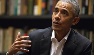 Former President Barack Obama  speaks to Obama Foundation Fellows gathered at Stony Island Arts Bank Wednesday, May 17, 2018, in Chicago.  (Erin Hooley/Chicago Tribune via AP) ** FILE **