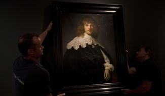 A painting attributed to famous Dutch Master Rembrandt is put on display at the Hermitage museum in Amsterdam, Netherlands, Wednesday, May 16, 2018. The unsigned painting which will be sold by gallery owner Jan Six, after being exhibit for a month at the Hermitage Amsterdam. (AP Photo/Peter Dejong)