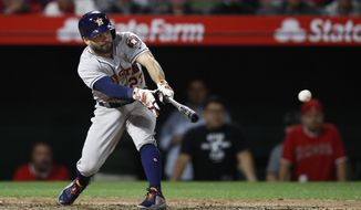 Houston Astros' Jose Altuve connects for a three-run double during the eighth inning of a baseball game against the Los Angeles Angels on Tuesday, May 15, 2018, in Anaheim, Calif. (AP Photo/Jae C. Hong)