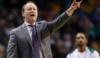 FILE - In this April 8, 2018, file photo, Atlanta Hawks coach Mike Budenholzer signals during the third quarter of the team's NBA basketball game against the Boston Celtics in Boston. A person familiar with the search tells The Associated Press that the Milwaukee Bucks have reached agreement with Budenholzer to become the team's next coach. The 2015 NBA Coach of the Year will replace Joe Prunty, the former assistant who went 21-16 in the regular season after replacing the fired Jason Kidd in late January. (AP Photo/Michael Dwyer, File)
