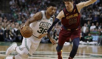 Boston Celtics guard Marcus Smart, left, drives against Cleveland Cavaliers guard Kyle Korver during the second half in Game 2 of the NBA basketball Eastern Conference finals, Tuesday, May 15, 2018, in Boston. (AP Photo/Charles Krupa)