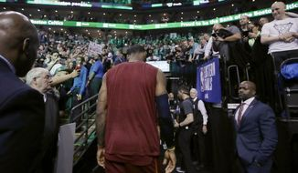 Cleveland Cavaliers forward LeBron James heads off the court after the team's 107-94 loss to the Boston Celtics in Game 2 of the NBA basketball Eastern Conference finals Tuesday, May 15, 2018, in Boston. (AP Photo/Charles Krupa)
