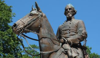 FILE - In this Aug. 18, 2017 file photo, the statue of Confederate Gen. Nathan Bedford Forrest sits in a park in Memphis, Tenn. The removal of three statues of Confederate leaders from public parks in Memphis, Tenn., did not violate state law because they were on private property when they were torn down, a judge ruled Wednesday, May 16, 2018. Davidson County Chancellor Ellen Hobbs Lyle in Nashville said the move by Memphis to bring down the statues of Gen. Forrest, Confederate President Jefferson Davis and Capt. J. Harvey Mathes from two city parks on Dec. 20 should not be blocked. (AP Photo/Adrian Sainz, File)