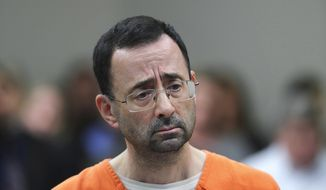In this Nov. 22, 2017, file photo, Dr. Larry Nassar appears in court for a plea hearing in Lansing, Mich. Michigan State University has reached a $500 million settlement with hundreds of women and girls who say they were sexually assaulted by Nassar in the worst sex-abuse case in sports history. The deal was announced Wednesday, May 16, 2018, by Michigan State and lawyers for 332 victims. (AP Photo/Paul Sancya, File)