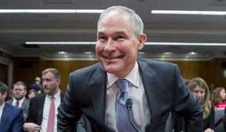 Environmental Protection Agency Administrator Scott Pruitt arrives to testify before a Senate Appropriations subcommittee on budget on Capitol Hill in Washington, Wednesday, May 16, 2018. Pruitt goes before a Senate panel Wednesday as he faces a growing number of federal ethics investigations over his lavish spending on travel and security. (AP Photo/Andrew Harnik)