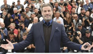 Actor John Travolta poses for photographers during a photo call for the film 'Gotti' at the 71st international film festival, Cannes, southern France, Tuesday, May 15, 2018. (Photo by Arthur Mola/Invision/AP)