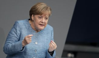 German Chancellor Angela Merkel, delivers a speech during a meeting of the German federal parliament, Bundestag, at the Reichstag building in Berlin, Germany, Wednesday, May 16, 2018. (AP Photo/Michael Sohn)