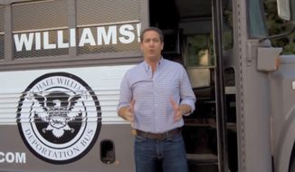 "In this frame from video provided by the Michael Williams for Governor campaign, Williams shows off his ""Deportation Bus"" in an advertisement. News outlets report Williams will bring the bus to what his campaign calls Georgia's ""dangerous sanctuary cities"" beginning Wednesday, May 16, 2018. (Michael Williams for Governor via AP)"