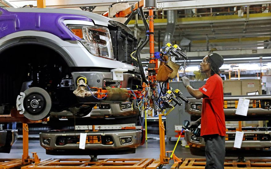 In this March 19, 2018, file photo, a line technician positions a truck front bumper for assembly at the Nissan Canton Assembly Plant, in Canton, Miss. (AP Photo/Rogelio V. Solis, File)