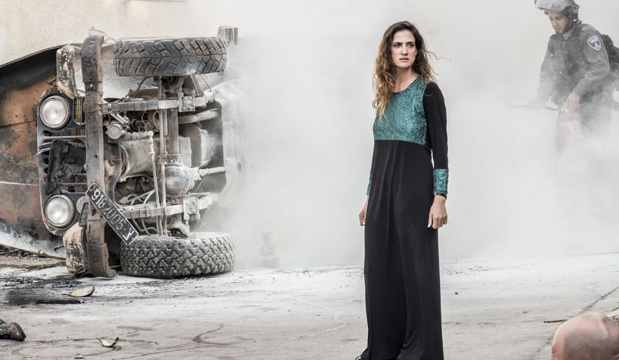 """This image released by Netflix shows Rona-Lee Shim'on in a scene from """"Fauda,""""an action series based on the tedium of the never-ending Mideast conflict. The second season premieres on May 24. (Ronen Akerman/Netflix via AP)"""