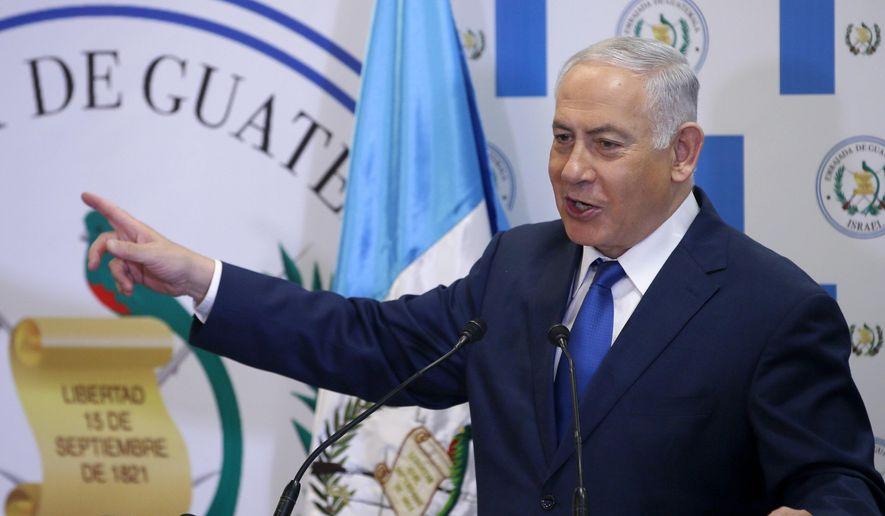 Israel Prime Minister Benjamin Netanyahu gestures as he speaks during the dedication ceremony of the Guatemala Embassy in Jerusalem, Israel, Wednesday May 16, 2018. (Ronen Zvulun/Pool via AP)