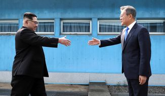In this April 27, 2018, file photo, North Korean leader Kim Jong Un, left, prepares to shake hands with South Korean President Moon Jae-in over the military demarcation line at the border village of Panmunjom in Demilitarized Zone.  After a few months of rapprochement, North Korea abruptly called off scheduled high-level talks with South Korea on Wednesday, May 16, 2018, and warned the U.S. that a planned summit with President Donald Trump could be at risk. (Korea Summit Press Pool via AP, File)