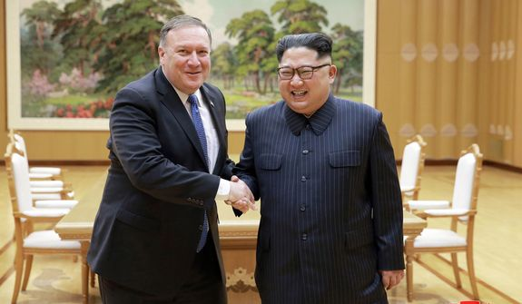 """FILE - In this May 9, 2018, file photo provided by the North Korean government, U.S. Secretary of State Mike Pompeo, left, shakes hands with North Korean leader Kim Jong Un during a meeting at Workers' Party of Korea headquarters in Pyongyang, North Korea. After a few months of rapprochement, North Korea abruptly called off scheduled high-level talks with South Korea on Wednesday, May 16, 2018,  and warned the U.S. that a planned summit with President Donald Trump could be at risk. Independent journalists were not given access to cover the event depicted in this image distributed by the North Korean government. The content of this image is as provided and cannot be independently verified. Korean language watermark on image as provided by source reads: """"KCNA"""" which is the abbreviation for Korean Central News Agency. (Korean Central News Agency/Korea News Service via AP, File)"""