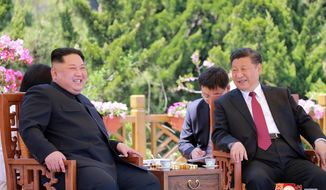 """FILE - In this May 8, 2018, file photo provided by the North Korean government, North Korean leader Kim Jong Un, left, meets Chinese President Xi Jinping in Dalian, China.  After a few months of rapprochement, North Korea abruptly called off scheduled high-level talks with South Korea on Wednesday, May 16, 2018,  and warned the U.S. that a planned summit with President Donald Trump could be at risk.  Independent journalists were not given access to cover the event depicted in this image distributed by the North Korean government. The content of this image is as provided and cannot be independently verified. Korean language watermark on image as provided by source reads: """"KCNA"""" which is the abbreviation for Korean Central News Agency. (Korean Central News Agency/Korea News Service via AP, File)"""