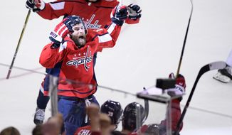 Washington Capitals right wing Brett Connolly (10) celebrates his goal during the second period of Game 3 of the NHL Eastern Conference finals hockey playoff series against the Tampa Bay Lightning, Tuesday, May 15, 2018 in Washington. (AP Photo/Nick Wass) ** FILE **
