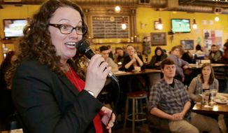 FILE - In this April 5, 2018, file photo, Kara Eastman, one of two Democrats vying to challenge 2nd District House incumbent Don Bacon, R-Neb., campaigns in Omaha, Neb. The Omaha-based 2nd Congressional District has changed party hands twice in the past two elections, and Democrats Brad Ashford and Kara Eastman are optimistic they can defeat first-term U.S. Rep. Don Bacon. Democratic and independent voters will pick Ashford or Eastman as the party's nominee in the primary election, Tuesday, May 15, 2018. (AP Photo/Nati Harnik, File)