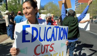 FILE - In this March 27, 2017 file photo, Democratic Party of New Mexico chair Debra Haaland is among protesters outside a luncheon attended by Republican Gov. Susana Martinez in Albuquerque, N.M. Haaland, a member of Laguna Pueblo, aspires to be the nation's first Native American congresswoman. Haaland will join in on a forum Tuesday, May 15, 2018 at the University of New Mexico which is geared toward Albuquerque's Latino community (AP Photo/Susan Montoya Bryan, File)
