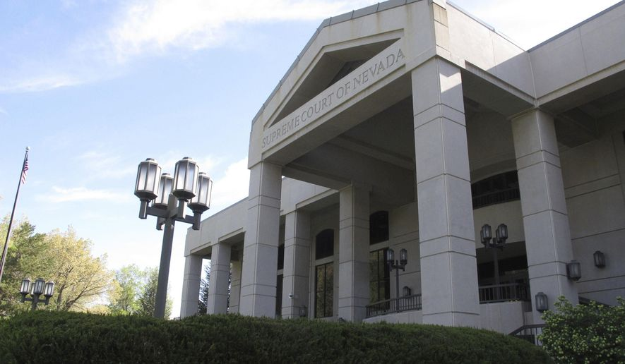 FILE - This May 8, 2018 file photo shows the Nevada Supreme Court in Carson City, Nev. A legal battle in Nevada over a proposed ballot initiative that seeks to ban so-called sanctuary cities is headed back to state court. In a 6-1 ruling Wednesday, May 16, 2018, the Nevada Supreme Court overturned part of a district court order that would keep the measure off the November ballot. But the justices say more changes are needed before it can go to the voters. (AP Photo/Scott Sonner, file)