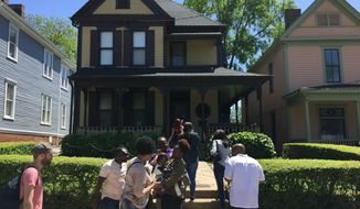 This April 29, 2018 photo shows the house in Atlanta where Martin Luther King, Jr. was born and lived until the age of 12. Nearby attractions include a National Park Service visitor center with exhibits about his life and the civil right movement, along with the King Center and the tomb where King and his wife Coretta Scott King are interred across from an eternal flame. (AP Photo/Beth J. Harpaz)