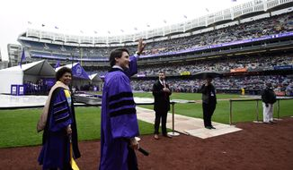 Prime Minister Justin Trudeau takes part in the procession prior to delivering the commencement address to New York University graduates at Yankee Stadium in New York on Wednesday, May 16, 2018. THE CANADIAN PRESS/Sean Kilpatrick/The Canadian Press via AP)