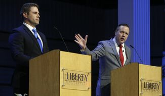 "Virginia state Delegate Nick Freitas (left) says he supports key aspects of President Trump's agenda but that senators don't sign a ""loyalty oath."" Corey Stewart, one of his opponents in the Republican senatorial primary on Tuesday, has billed himself as the only true pro-Trump candidate. Chesapeake Bishop E.W. Jackson (not pictured), the only black candidate in the race, said the president isn't getting enough backing from congressional Republicans and that he is the person to change that. (Associated Press/File)"