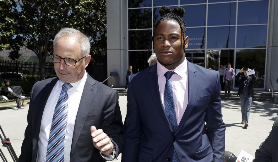 San Francisco 49ers linebacker Reuben Foster, right, leaves the Santa Clara County Superior Court, with his attorney Joshua Bentley after a preliminary hearing stemming from domestic violence accusations against Foster Thursday, May 17, 2018, in San Jose, Calif. Foster's ex-girlfriend, Elissa Ennis, recanted allegations Thursday that Foster physically assaulted her. She testified that she lied to authorities about the domestic assault to get back at Foster for breaking up with her. (AP Photo/Marcio Jose Sanchez) **FILE**