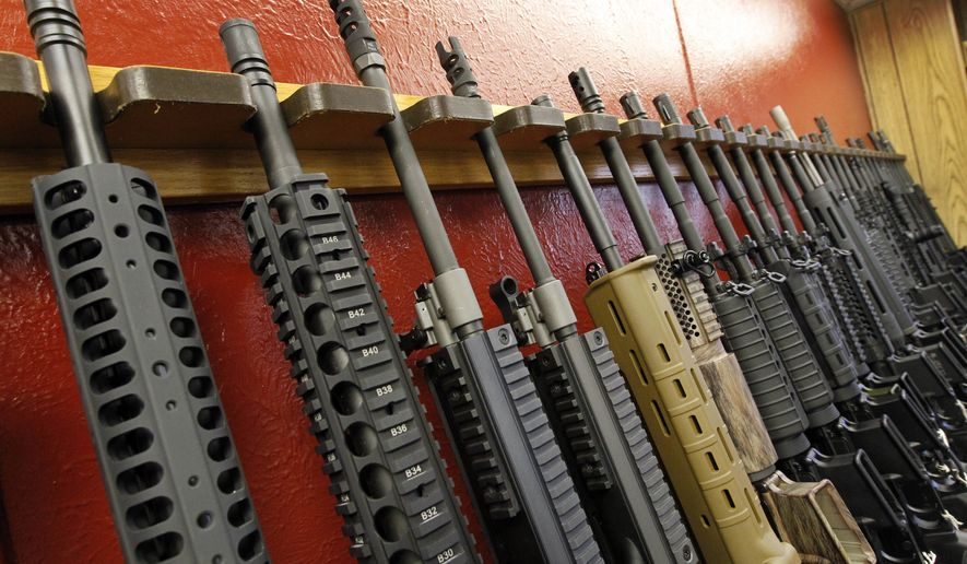FILE - In this July 20, 2012, file photo, a row of different AR-15 style rifles are displayed for sale at the Firing-Line indoor range and gun shop in Aurora, Colo. The right to bear arms is fundamental to the U.S., carved into the Constitution and seemingly embedded in the national DNA. But after a seemingly endless stretch of violence, Americans are confronting how far those rights extend, propelling gun issues to the forefront of this years elections. (AP Photo/Alex Brandon, File)