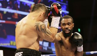 Oscar Escandon, left, and Gary Russell Jr. battle in the WBC featherweight title fight at MGM National Harbor in Oxon Hill, Md., Saturday, May 20, 2017. (AP Photo/Mark Tenally) **FILE**