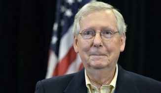 Senate Majority Leader Mitch McConnell, R-Ky., reacts to a reporters question during a press conference Saturday, Dec. 2, 2017, in Louisville, Ky. The Senate passed the tax bill early Saturday morning with a 51-49 vote. (AP Photo/Timothy D. Easley)