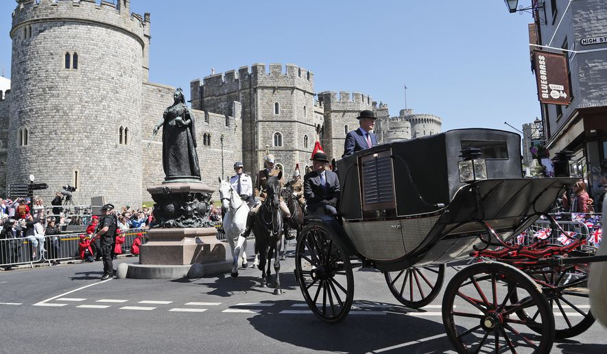 A carriage is driven through the streets of Windsor, England during a rehearsal for the procession of the upcoming wedding of Britain's Prince Harry and Meghan Markle, Thursday, May 17, 2018. Preparations are being made in the town ahead of the wedding of Britain's Prince Harry and Meghan Markle that will take place in Windsor on Saturday May 19.(AP Photo/Frank Augstein)