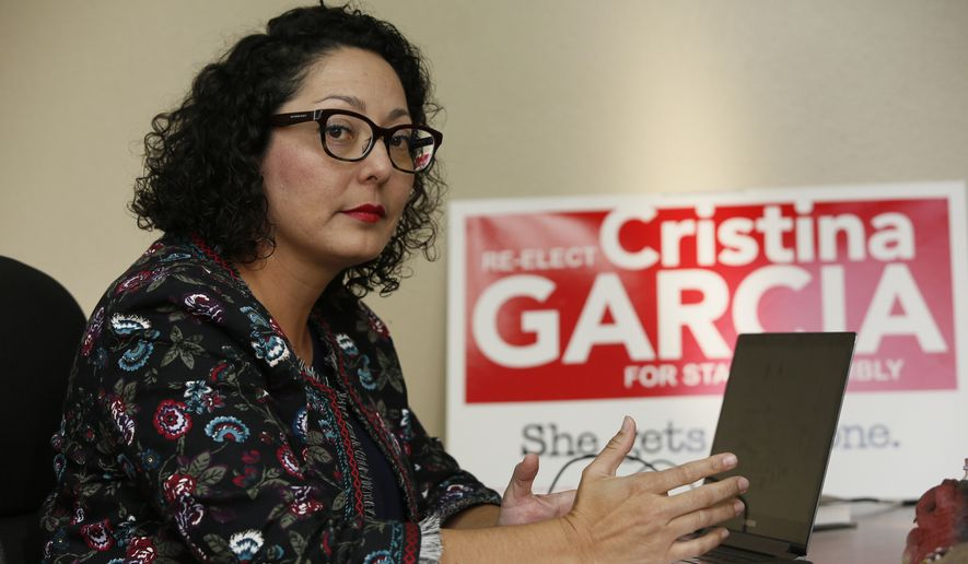 In this April 27, 2018, photo, California Assemblywoman Cristina Garcia, D-Bell Gardens, poses for a picture at her campaign headquarters in Downey, Calif. Outside investigators on Thursday, May 17, cleared Garcia, who was once at the forefront of the state's #MeToo movement of allegations that she groped a male staff member in 2014. (AP Photo/Damian Dovarganes)