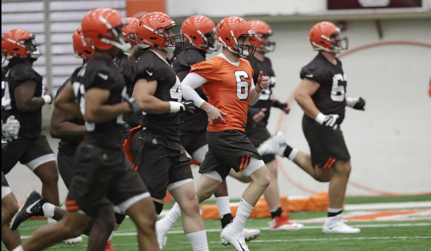 "FILE - In this May 4, 2018, file photo, Cleveland Browns quarterback Baker Mayfield (6) runs a drill during rookie minicamp at the NFL football team's training camp facility in Berea, Ohio. A person familiar with the decision says the Browns will appear on HBO's ""Hard Knocks"" this season. Coming off a historic 0-16 season, the Browns were chosen after declining the opportunity several times, said the person who spoke Thursday, May 17, to The Associated Press on condition of anonymity. (AP Photo/Tony Dejak, File) **FILE**"