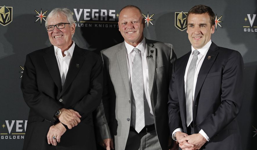 FILE - In this April 13, 2017, file photo, Vegas Golden Knights coach Gerard Gallant is flanked by owner Bill Foley, left, and general manager George McPhee during an NHL hockey news conference in Las Vegas. Foley bought much more than just an NHL team when he paid a whopping $500 million for an expansion franchise. The Knights' improbable success is all built on the incredibly favorable expansion draft terms given to their deep-pocketed owner. He has been rewarded with an incredible debut season from that uncommonly deep collection of talent. (AP Photo/John Locher, File)