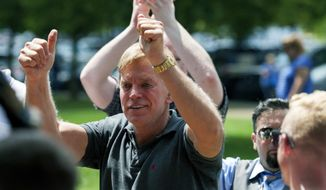 FILE - In an Aug. 12, 2017 file photo, David Duke arrives to give remarks after a white nationalist protest was declared an unlawful assembly, in Charlottesville, Va. Former Ku Klux Klan leader David Duke must turn over his emails, social media messages and other communications about the white nationalist rally in Charlottesville, Virginia, that turned deadly last summer, a federal magistrate ruled Thursday, May 17, 2018.  (Shaban Athuman/Richmond Times-Dispatch via AP, File)