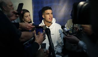 Michael Porter Jr., from Missouri, speaks to reporters during the NBA draft basketball combine Thursday, May 17, 2018, in Chicago. (AP Photo/Charles Rex Arbogast)