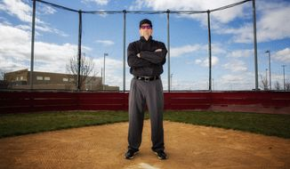Umpire Randy Bernhard poses for a portrait Wednesday, April 4, 2018, at Canyon Ridge High School in Twin Falls, Idaho. The number of officials in the state has steadily decreased over the last decade, and Idaho is a microcosm of a nationwide shortage. Officials have cited several explanations for the poor numbers, namely abuse from parents and coaches, and they have struggled to find solutions.   (Pat Sutphin/The Times-News via AP)