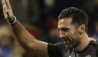 FILE - In this Monday, Nov. 13, 2017 filer, Italy's goalkeeper Gianluigi Buffon waves as he leaves the pitch after the elimination of his team in the World Cup qualifying play-off second leg soccer match between Italy and Sweden, at the Milan San Siro stadium, Italy. Juventus captain Gianluigi Buffon has announced he is leaving the Italian club but the goalkeeper could continue playing elsewhere. Buffon, who is widely regarded as one of the best goalkeepers of all time, was expected to announce his retirement at a press conference at Allianz Stadium on Thursday, May 17, 2018. (AP Photo/Luca Bruno, File)