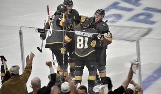 Vegas Golden Knights center Jonathan Marchessault (81) celebrates with teammates after scoring during the first period of Game 3 of the NHL Western Conference finals hockey playoffs series against the Winnipeg Jets on Wednesday, May 16, 2018, in Las Vegas. (AP Photo/David Becker)