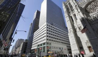 FILE - This March 29, 2017, file photo shows the 666 Fifth Avenue skyscraper, center, controlled by Kushner Cos., in New York. The company owned by the family of Jared Kushner is in talks to sell a stake in its struggling Fifth Avenue skyscraper to a real estate fund. Jared Kushner, President Donald Trump's son-in-law, bought the skyscraper for a record $1.8 billion more than a decade ago when he was CEO of his family's company, and the office building has been losing money ever since. (AP Photo/Richard Drew, File)