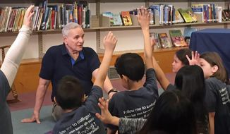 Minnesota Gov. Mark Dayton answers questions from students at Bruce Vento Elementary School on Thursday, May 17, 2018, in St. Paul, Minn., minutes before vetoing a tax bill passed by the GOP-controlled Legislature. The Democratic governor said the bill tilted too far toward the wealthy and corporations. Lawmakers have just four days left in the session to resolve tax changes made necessary by the federal overhaul, as well as other major priorities. (AP Photo/Youssef Rddad)