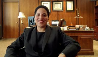 """In this Wednesday, May 16, 2018, photo, St. Louis Circuit Attorney Kim Gardner poses for a photo in her office in St. Louis. Attorneys for Missouri Gov. Eric Greitens twice threatened to """"ruin"""" Gardner if she didn't back off investigations of the governor, Gardner said in an interview with The Associated Press Wednesday, May 16, 2018. Gardner spoke two days after her office dismissed an invasion of privacy case stemming from Greitens' 2015 affair with his St. Louis hairdresser. She said a decision is expected by June 1 on whether to refile the felony charge. (AP Photo/Jim Salter)"""
