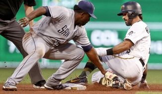 Pittsburgh Pirates' Sean Rodriguez, right, slides into second with a double ahead of the tag by San Diego Padres second baseman Jose Pirela during the fourth inning of a baseball game, Thursday, May 17, 2018, in Pittsburgh. Rodriguez drove in Corey Dickerson with the hit. (AP Photo/Keith Srakocic)