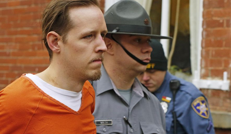 FILE – In this Oct. 31, 2014, file photo, Eric Frein, left, is escorted out by police after his arraignment at the Pike County Courthouse in Milford, Pa. Lawyers for Frein, on death row for fatally shooting Pennsylvania State Police Cpl. Bryon Dickson II and wounding Trooper Alex Douglass in Sept. 2014, were scheduled to argue before the state Supreme Court on Thursday, May 17, 2018, that the justices should throw out Frein's conviction. (AP Photo/Rich Schultz, File)