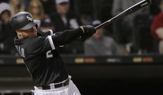 Chicago White Sox's Welington Castillo hits two-run single against the Texas Rangers during the eighth inning of a baseball game Thursday, May 17, 2018, in Chicago. (AP Photo/Nam Y. Huh)