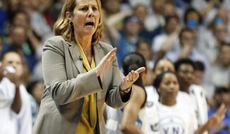 FILE - In this Oct. 4, 2017, file photo, Minnesota Lynx head coach Cheryl Reeve applauds here team during the first half of Game 5 of the WNBA Finals against the Los Angeles Sparks in Minneapolis. The defending champion Minnesota Lynx begin the season atop The Associated Press WNBA poll. The Lynx received nine first-place votes from the 14-person national media panel Thursday, May 17, 2018. ( (AP Photo/Jim Mone, File)