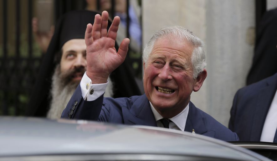 In this Thursday, May 10, 2018, file photo, Britain's Prince Charles, waves as he leaves a meeting with the head of Greece's Orthodox Church Archbishop Ieronymos, in Athens. Kensington Palace announced on Friday, May 18, 2018, Prince Charles will walk Meghan Markle down the aisle in her wedding to Prince Harry. (AP Photo/Petros Giannakouris)