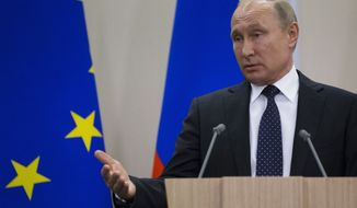 Russian President Vladimir Putin gestures while speaking at a joint news conference after meeting with German Chancellor Angela Merkel at Putin's residence in the Russian Black Sea resort of Sochi, Russia, Friday, May 18, 2018. (AP Photo/Alexander Zemlianichenko)