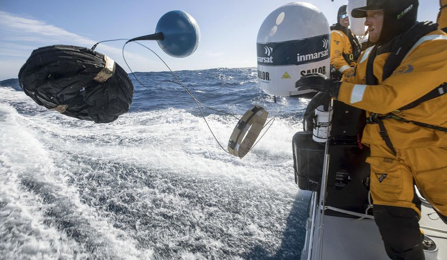 "In this March 21, 2018 photo provided by Volvo Ocean Race, Frederico de Melo deploys a scientific drifter to test the water for evidence of pollution in the Pacific Ocean from aboard the vessel ""Turn the Tide on Plastic,"" during the race leg from New Zealand to Brazil.  For the sailors, teams, organizers and sponsors, the Volvo Ocean Race is part of a larger race against time, a mission to curb the use of products that litter the ocean and befoul the air. (Sam Greenfield/Volvo Ocean Race via AP)"