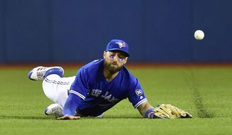Toronto Blue Jays center fielder Kevin Pillar cannot make it to a fly ball hit for a double by Oakland Athletics' Jed Lowrie during sixth-inning baseball game action in Toronto, Friday, May 18, 2018. (Frank Gunn/The Canadian Press via AP)