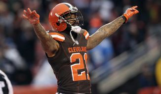 FILE - In this Dec. 24, 2016, file photo, Cleveland Browns' Jamar Taylor gestures during an NFL football game against the San Diego Chargers in Cleveland. A person with knowledge of the situation says the Arizona Cardinals are finalizing a trade that would bring cornerback Jamar Taylor from the Cleveland Browns. The person, who sought anonymity because the trade had not been officially announced, said the deal was expected to be completed later in the day Friday, May 18, 2018. (AP Photo/Aaron Josefczyk, File)
